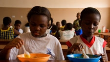 Children having a meal at school. Ghana