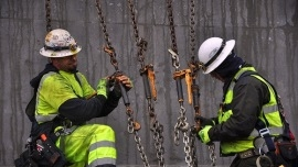 Men working at a construction site. Photo credit: WSDOT, Flickr Creative Commons.