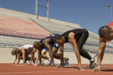 Athletes at starting blocks. © Photographerlondon | Dreamstime.com