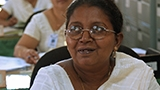 Female health worker smiling in Sri Lanka.
