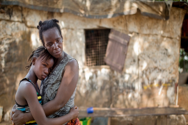 &#65&#100&#97&#109&#97&#32&#97&#110&#100&#32&#104&#101&#114&#32&#109&#111&#116&#104&#101&#114&#44&#32&#77&#97&#114&#105&#97&#116&#117&#44&#32&#105&#110&#32&#102&#114&#111&#110&#116&#32&#111&#102&#32&#116&#104&#101&#105&#114&#32&#104&#111&#109&#101&#32&#105&#110&#32&#83&#105&#101&#114&#114&#97&#32&#76&#101&#111&#110&#101&#46&#32&#169&#32&#68&#111&#109&#105&#110&#105&#99&#32&#67&#104&#97&#118&#101&#122&#47&#87&#111&#114&#108&#100&#32&#66&#97&#110&#107