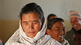 A woman speaks at a community meeting on water and sanitation in Nepal. - Photo: Simone D. McCourtie/World Bank