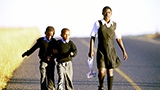 South African children walking to school.
