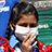 In Bangladesh, a young girl protects herself with an anti-pollution mask