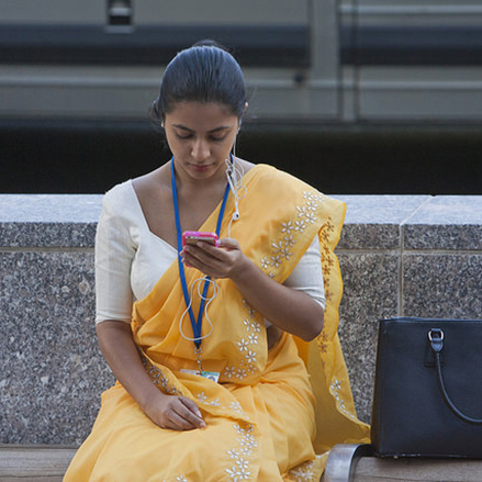A woman uses her smartphone in Washington, DC.