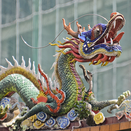 A dragon sculpture on a Chinese temple rooftop in Kuala Lumpur. Malaysia