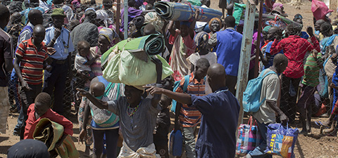 UNHCR helps hundreds of refugees cross the border near Nadapal, Kenya as they flow in from South Sudan. © Dominic Chavez/International Finance Corporation