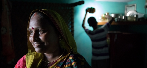 Prabha Vishwakarma (left) with her son talks about improvements of having solar energy in their home in Bhormarmafi Village, India. © Dominic Chavez/International Finance Corporation