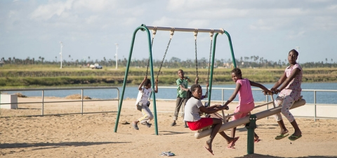 Children at a play area in Beira, Mozambique. In addition to building and rehabilitating roads , basins and drainage canals, the IDA-funded Cities and Climate Change Project also included a provision for play areas that cater to children in some of the city's most impoverished neighborhoods. © Sarah Farhat/World Bank