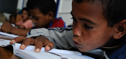 Children read in their classroom at a school in Morocco. Photo: © Dana Smillie/World Bank
