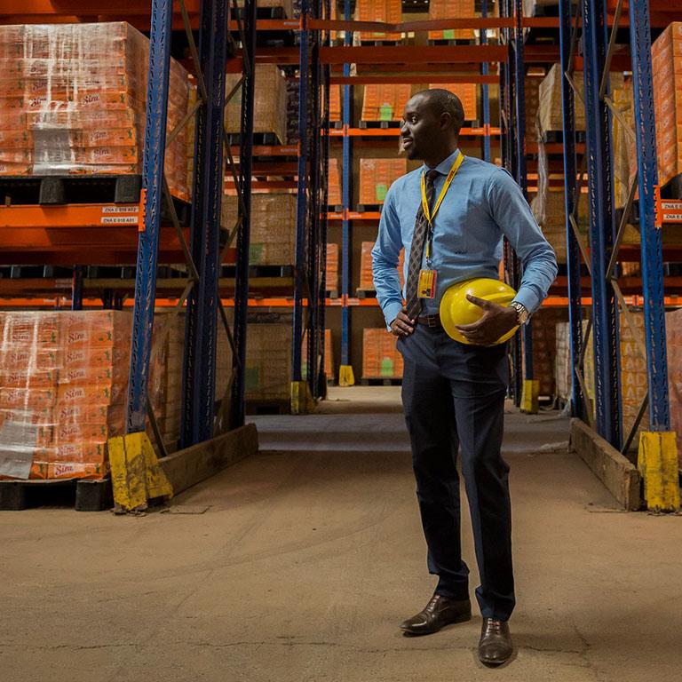 A man in Senegal stands in a warehouse in Senegal