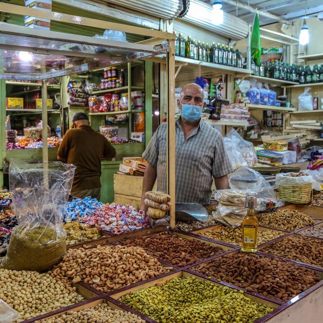 Shop owner in Shorja Market, Baghdad, Iraq, April 2020