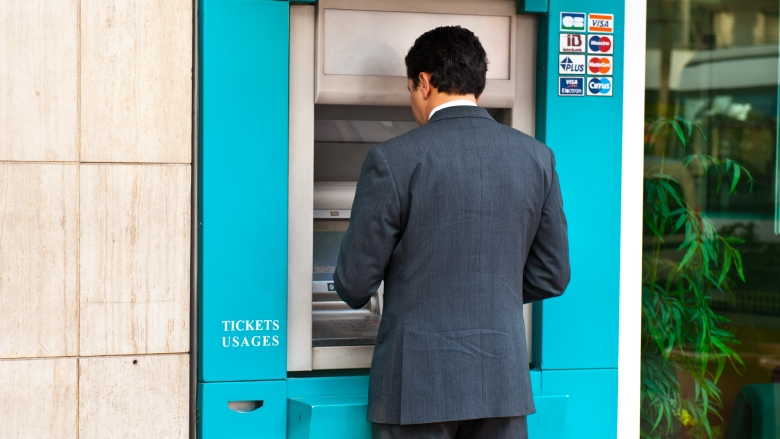 Photo: Arne Hoel l World Bank - Man at an ATM machine