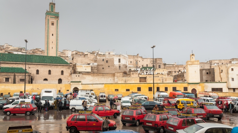 Square with red petit taxis in the medina of Fez, Morocco