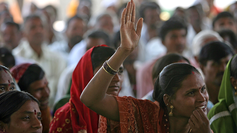 Women participate in a community meeting in rural India.