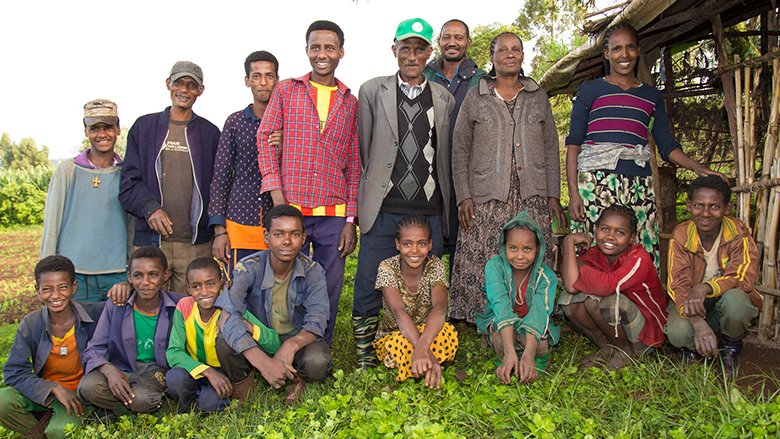 Using data from EthioSIS, Fikadu Garomessa learned which crops and fertilizers are best suited to the soil in his area.  His yields and profits are up, and with the increase in income, he can now send his children to school. Photo: Dasan Bobo