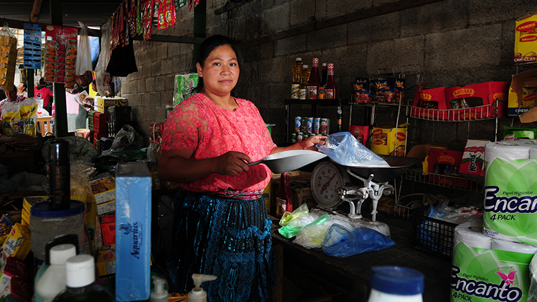 A woman attends her post in a market in Guatemala City. Guatemala.