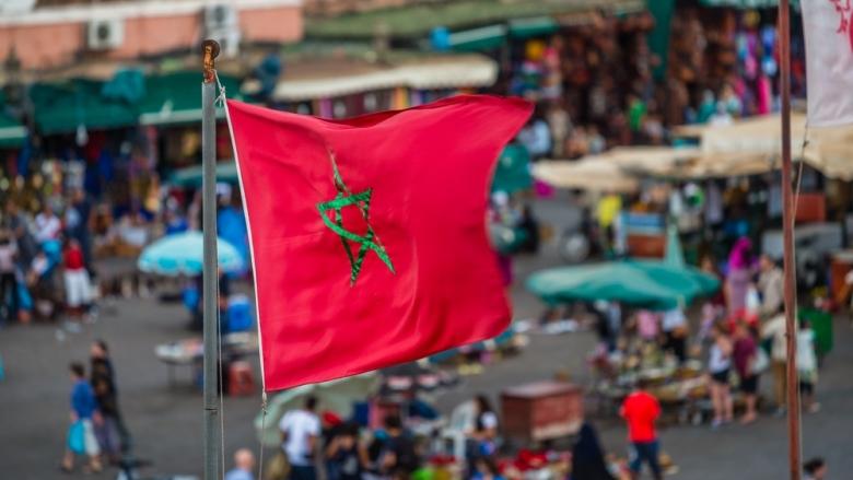 Moroccan flag over Djemaa El Fna - Copyright: Shanti Hesse | Shutterstock.com