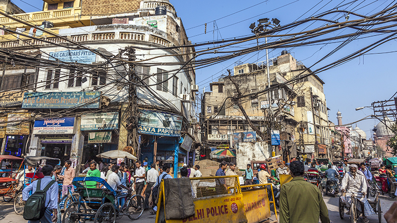 People in old Delhi in Chawri Bazaar, the famous old market in Delhi, India. (c) Shutterstock