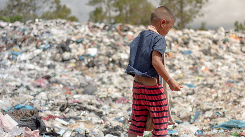 A Child at a Landfill. Photo credit: Tinnakorn jorruang / Shutterstock