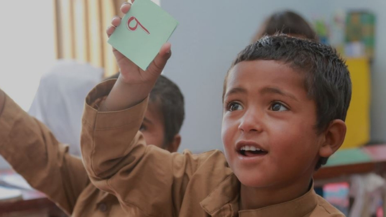 First grade students in Pakistan's Balochistan Province are learning the alphabet through child-friendly flash cards. Their learning materials help educators teach through interactive and engaging activities and are provided free of charge through a student's first learning backpack. © World Bank