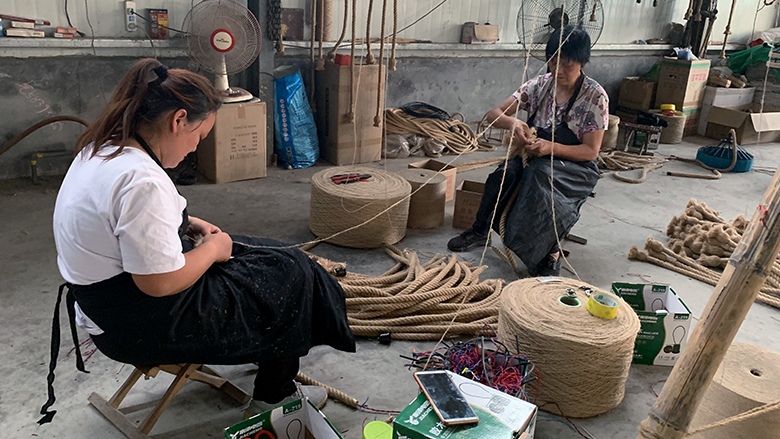 Two women weave rope in one of China
