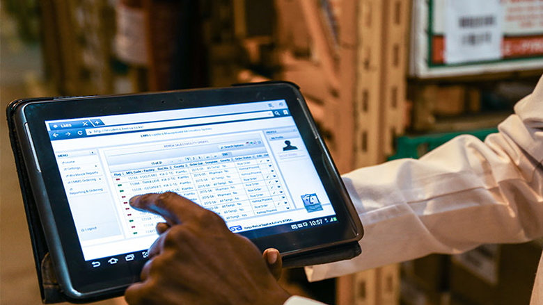 A man in Kenya demonstrates a logistics management information system. Photo: Sarah Farhat/ The World Bank