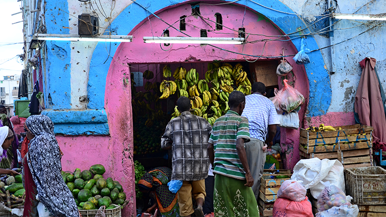 People browse fruit for sale at a food stall in Djibouti