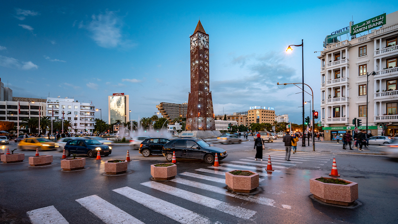 Cars circle a roundabout on Habib Bourguiba Avenue in Tunisia.