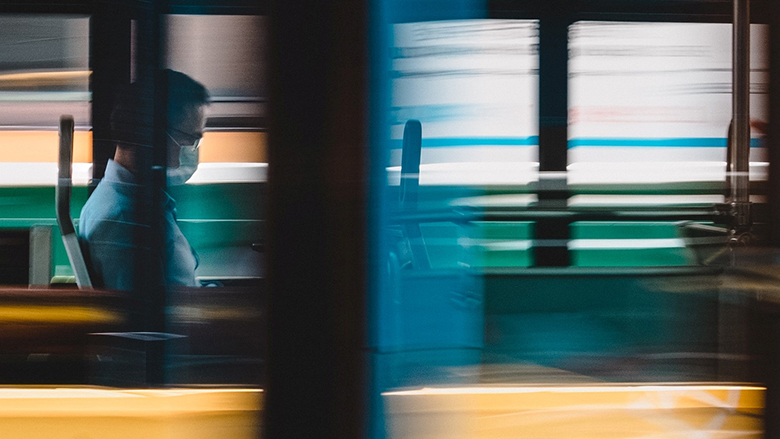 A man wearing a mask on a bus. Photo: © Chapman Chow/Unsplash