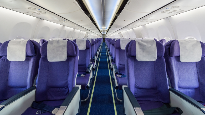 Empty passenger airplane seats in the cabin. Photo: © tratong/shutterstock