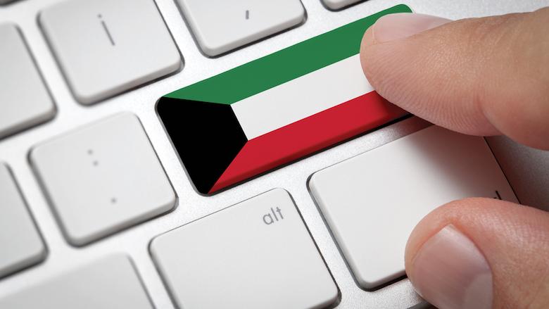 A key on a computer keyboard displays the Kuwait flag.