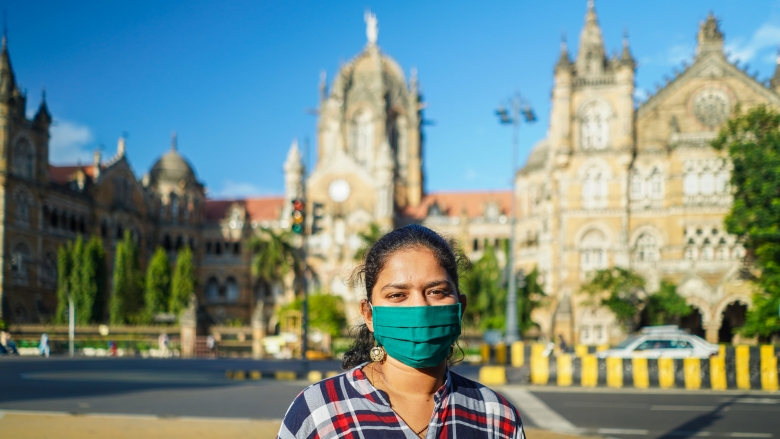 A young Indian woman wearing a mask in Mumbai. Photo credit: Kunal Umesh Mohite/Shutterstock.com