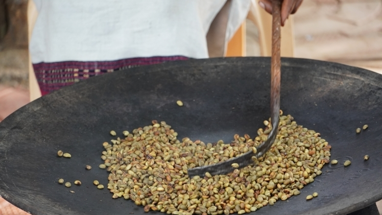 Wild Arabica coffee beans being roasted.