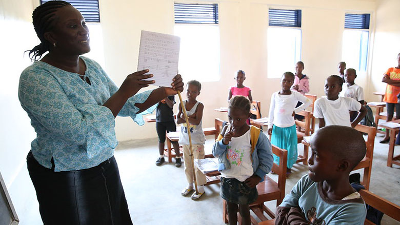 A teacher talks to her students during class at Billy Town Public School in Billy Town, Liberia after the threat of Ebola outbreak diminishes on March 5, 2015. Photo: Dominic Chavez/World Bank