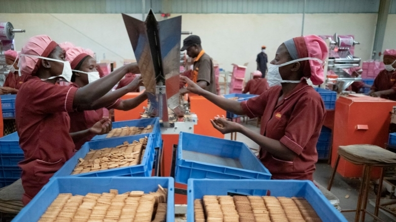 Employees working at a biscuit factory in Kigali, Rwanda. Photo © Dominic Chavez/International Finance Corporation