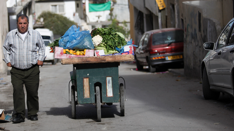 A vegetable trader having hard time selling the goods, West Bank.