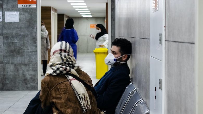 A young man and his wife wait for a coronavirus test in a hospital in Tehran, Iran.