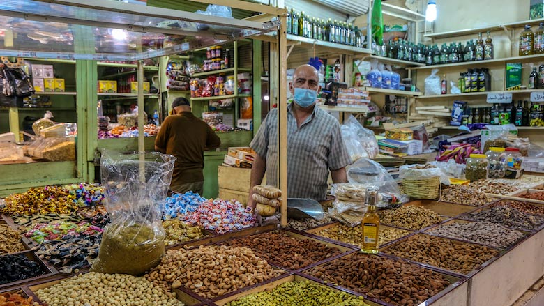 A man stands in his shop at the Shorja market in Baghdad.