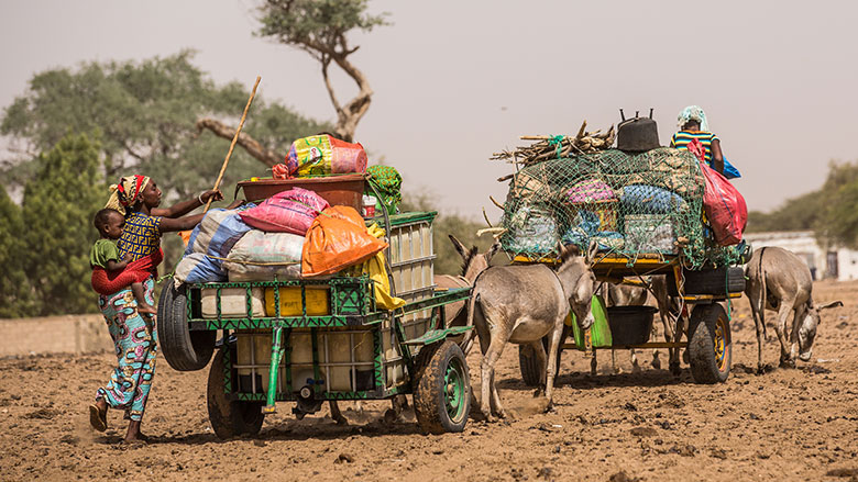 The herders leave with the animals, while the rest of the family follows by cart with all of the necessary supplies. Increasingly wives remain in the village with the youngest children so they can go to school. © Vincent Tremeau/World Bank