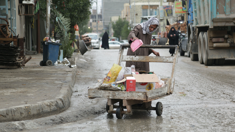 The World Bank - Iraq's Economic Update — April 2021 Najaf--Iraq---January---23--2020-The-damage-to-the-streets-due-to-rain-and-neglect-prevents-the-lives-of-people-in-Najaf-Najaf--Iraq--S-By-Sajjad-Harsh