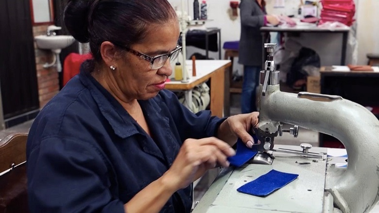 Woman worker in leather goods factory in Bogota, Colombia