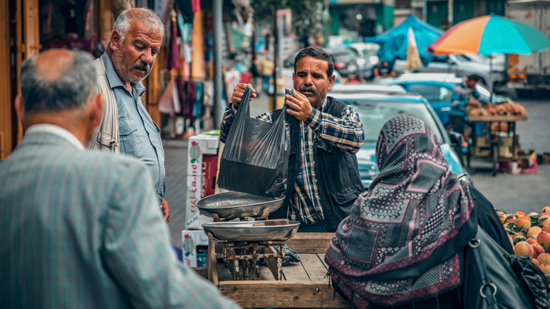 Palestinians are buying fruits in the flea market