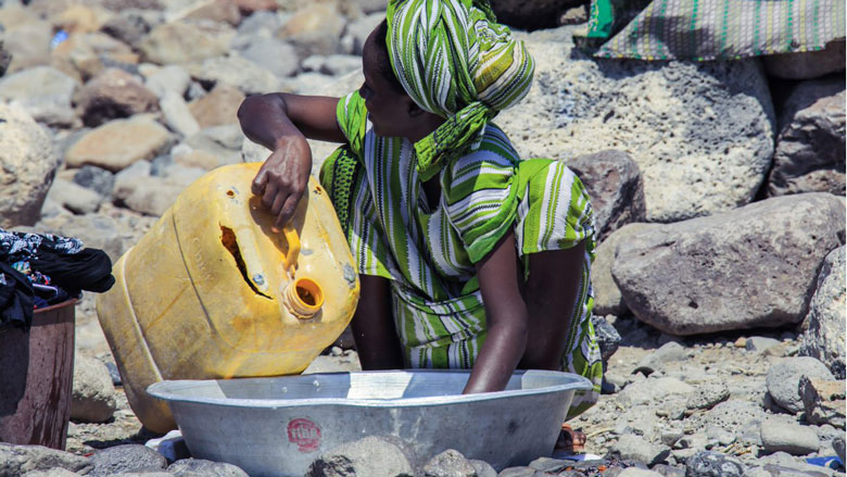 Poor woman in Djibouti-Ville washing clothes.
